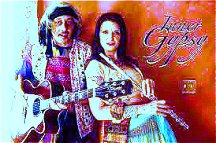 Image #1 of a gypsy playing guitar.