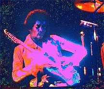 Image #2 of Jimi Hendrix playing guitar.