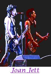 Image of Joan Jett playing guitar.