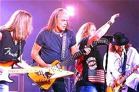 Image of Lynyrd Skynyrd in concert.