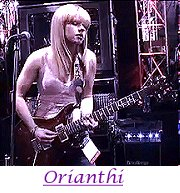 Image of Orianthi playing guitar.