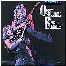 Image of Randy Rhoads playing guitar with Ozzy Osbourne.