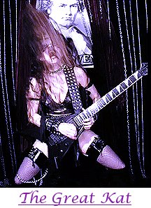 Yes, girls can shred too! The Great Kat playing guitar.